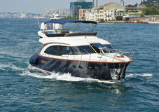 Private motor yacht sailing on river Stock Images
