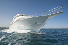 Private motor yacht at sea. Large luxury private motor yacht out on tropical sea Royalty Free Stock Images