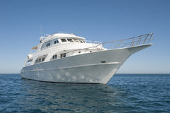 Private motor yacht at sea. Large luxury private motor yacht out on tropical sea Royalty Free Stock Photo