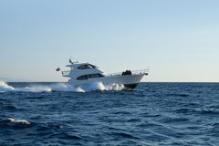 A private motor yacht. Under way out at sea Royalty Free Stock Photo