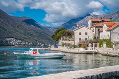 Private motorboat on the shore in Perast town. Small motor boat on the shore in the beautiful Perast town in the Kotor Bay, Montenegro stock images