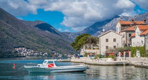 Private motorboat on the shore in Perast town. Small motor boat on the shore in the beautiful Perast town in the Kotor Bay, Montenegro royalty free stock images