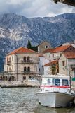 Private motorboat on the shore in Perast town. Small motor boat on the shore in the beautiful Perast town in the Kotor Bay, Montenegro royalty free stock photo