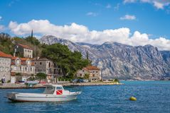 Private motorboat on the shore in Perast town. Small motor boat on the shore in the beautiful Perast town in the Kotor Bay, Montenegro royalty free stock photography
