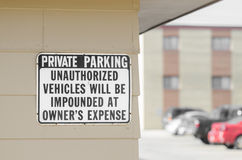 Private parking sign by parking lot Royalty Free Stock Image