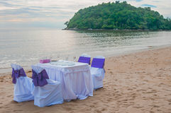 Private party. There are table and chairs setting on the beach. Seems like someone will have a little celebration Stock Image