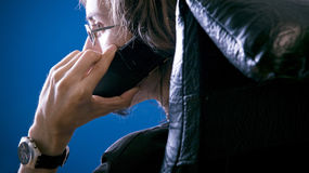 Private phone call stock image