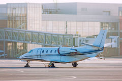 Private plane on the apron. Private plane on the airport apron Stock Photos
