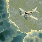 Private plane among clouds above ground. Royalty Free Stock Photo