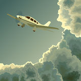 Private plane among clouds at dusk. Royalty Free Stock Images