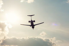 Private plane landing. In backlight Royalty Free Stock Images
