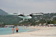 Private plane landing on the beach of St.Barth. St.Barth, June 2011 - A private plane landing in the third most dangerous airport of the world, very close to the stock photography