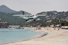 Private plane landing on the beach of St.Barth Stock Photos