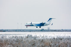 Private plane landing at the winter airport. Private plane landing at the cold winter airport stock images