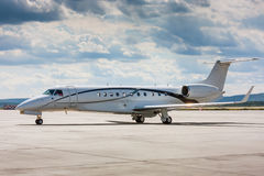 Private plane on the main taxiway. In the airport royalty free stock photos