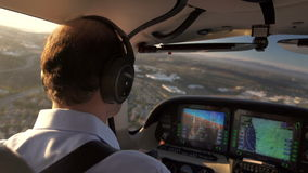 Private Plane Pilot Navigating and Flying Into Sunset Stock Image