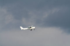 Private plane on a strormy sky Stock Images