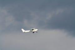 Private plane on a strormy sky. Light private plane on a grey strormy sky stock images