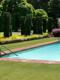 Private pool in a luxurious garden Stock Photos
