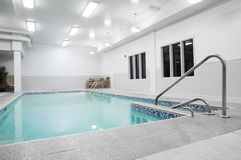 Small Private Indoor Pool. Private Pool Stairs and blue water Royalty Free Stock Photo