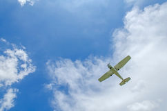 Private propeller plane in blue sky. Stock Images