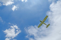 Private propeller plane in blue sky. Royalty Free Stock Photos