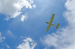 Private propeller plane in blue sky. Royalty Free Stock Photography