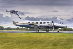 Private propeller airplane. Private propeller plane parking at rural airport Stock Photography