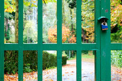 Private property. Iron gate with padlock in private autumnal garden Stock Photography