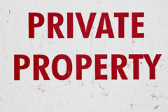 Private Property. Old private property sign with marks and scratches Royalty Free Stock Photography