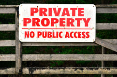 Private property. A sigh on a fence reads: PRIVATE PROPERTY - NO PUBLIC ACCESS Royalty Free Stock Photo
