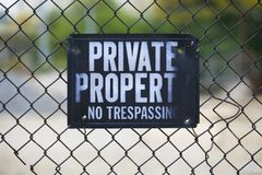 Private Property. Sign on a rusty chain link fence Stock Photos
