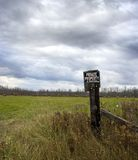 Private Property. View of Field with Threatening Dark Clouds Stock Image