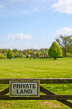 Private property beautiful view. A private sign on a gate, leading to a beautiful garden and private property area Royalty Free Stock Photography