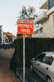 Private Property car house garage garden red sign Stock Photo