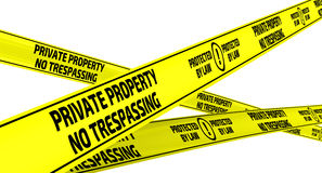 Private property. No trespassing. Protected by law. Yellow warning tapes Royalty Free Stock Photography