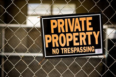Private Property Sign. Private property, no trespassing sign posted on chain link fence Stock Image