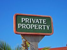 Private property sign. A picture of a private property sign, standing high against the sky Royalty Free Stock Photos