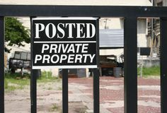 Private Property Sign. With abandoned lot in the background Stock Photo