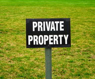 Private property. Sign on the green lawn Royalty Free Stock Image