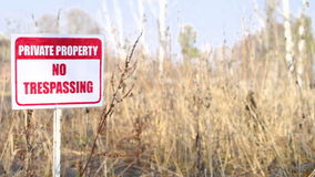 Private property sign on nature background stock video footage