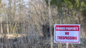 Private property sign on nature background stock footage