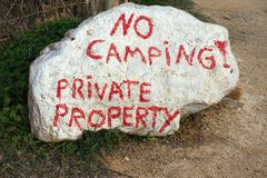 Private Property sign. Written in red on large white rock Stock Images