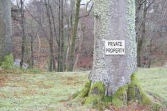 Private Property Sign on Tree in Country Land Estate. Private Property Sign on Tree at Country Land Estate to Warn Trespassers and Walkers Royalty Free Stock Image