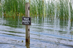 Private property sign in wetland Stock Photography