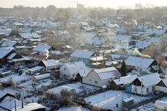 Private residential sector on the outskirts of a big city in a frosty winter day. Royalty Free Stock Images