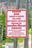Private road with hikers and bikers welcome sign stock photos
