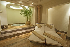 Private room in a luxury health spa. Beds and jacuzzi in a private VIP area of luxury health spa Royalty Free Stock Photo
