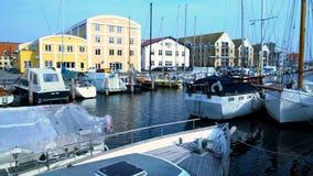 Private sailboats and yachts docked in Nyhavn harbor, Copenhagen city port. Stock photo stock photo