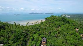 Private secluded villa on tropical island in remote location among green palm trees. Aerial View. Shot with a DJI Mavic fps29,97 4k stock video footage